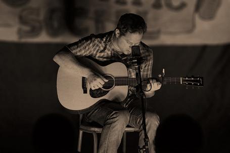 Shaun Cromwell playing guitar